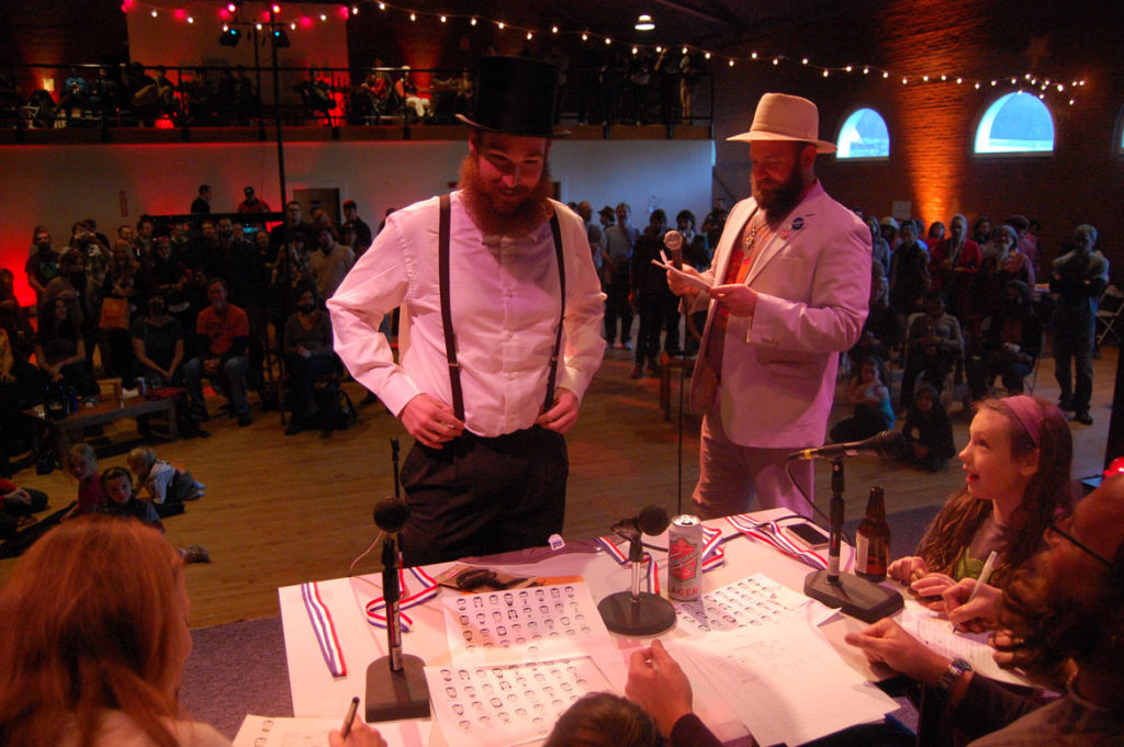 Dustin Taksar's natural full beard is reviewed by the judges. (Greg Cook)