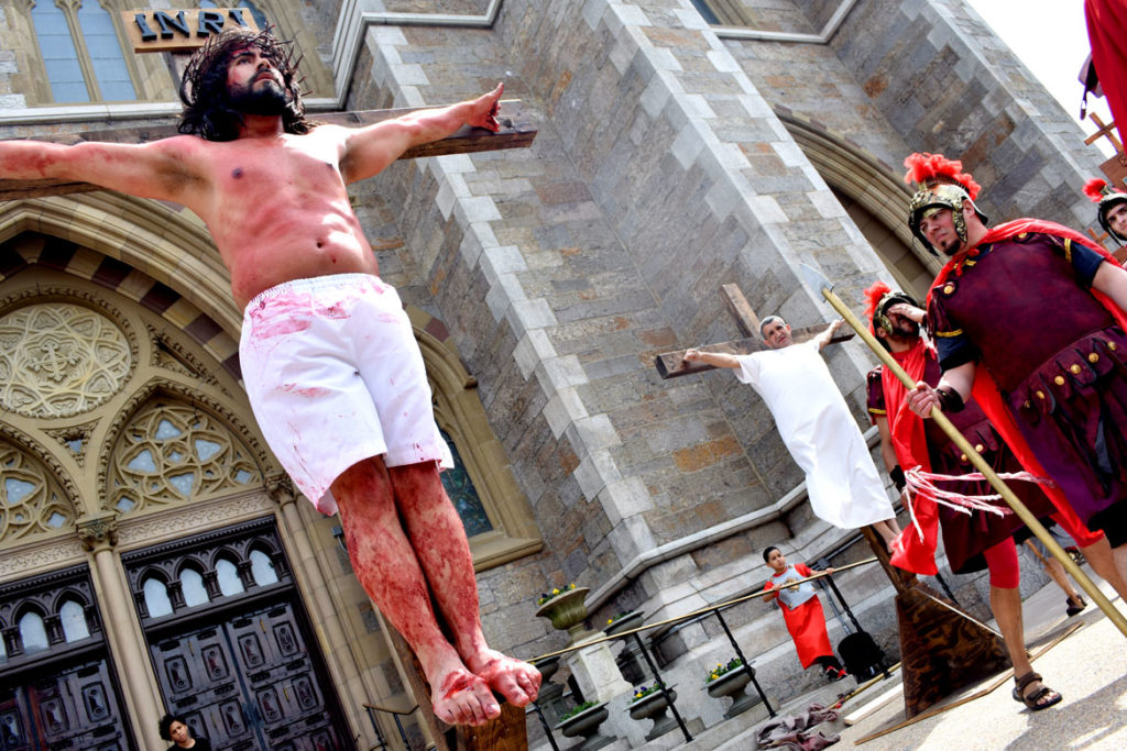 A Good Friday Stations of the Cross pageant for Easter performed in the neighborhood around Boston's Cathedral of the Holy Cross, April 19, 2019. (Greg Cook)
