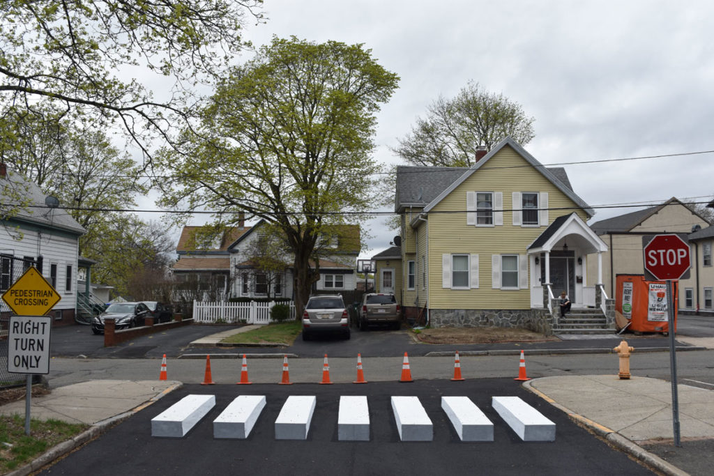 Optical illusion crosswalk painted by Nate Swain at Medford's Brooks Elementary School, April 20, 2019. (Greg Cook)