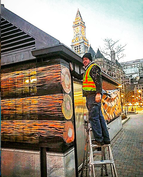 "Nate Swain installing ""Log Off"" along Boston's Greenway. (Courtesy)"