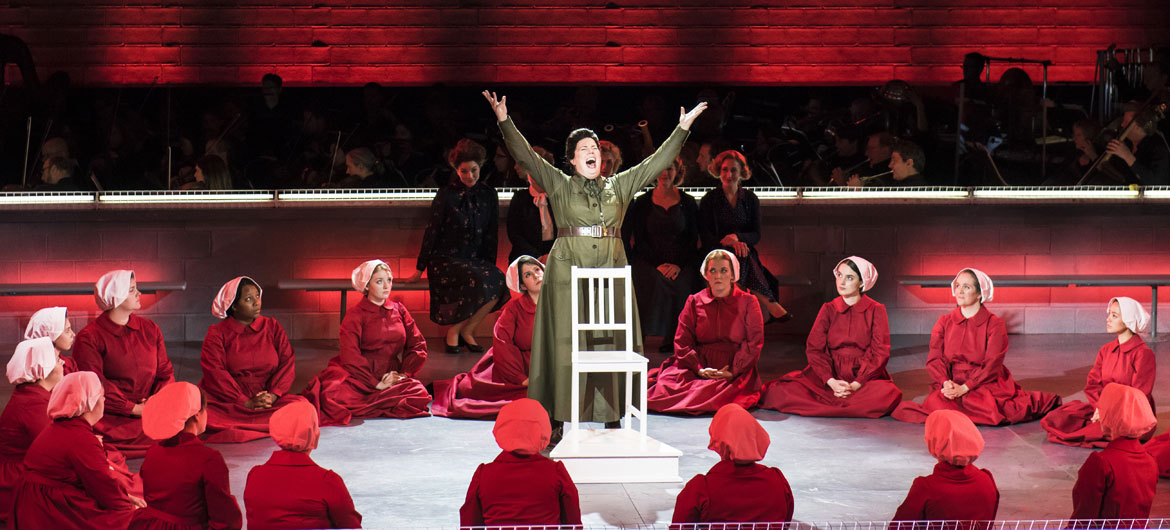 "Aunt Lydia (Caroline Worra) leads the handmaids in Boston Lyric Opera's production of ""The Handmaid's Tale,"" running through May 12, 2019. (Photo: Liza Voll)"