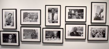 "Craig Bailey's ""The Faces of AIDS"" portrait photographs at the Cooper Gallery at Harvard University's Hutchins Center for African & African American Research, Nov. 8, 2018. (Greg Cook)"