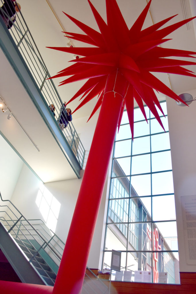 """""""Red Star,"""" 2014, inflatable sculpture, in """"Fire and Light: Otto Piene in Groton, 1983–2014"""" at the Fitchburg Art Museum, 2019. (Greg Cook)"""