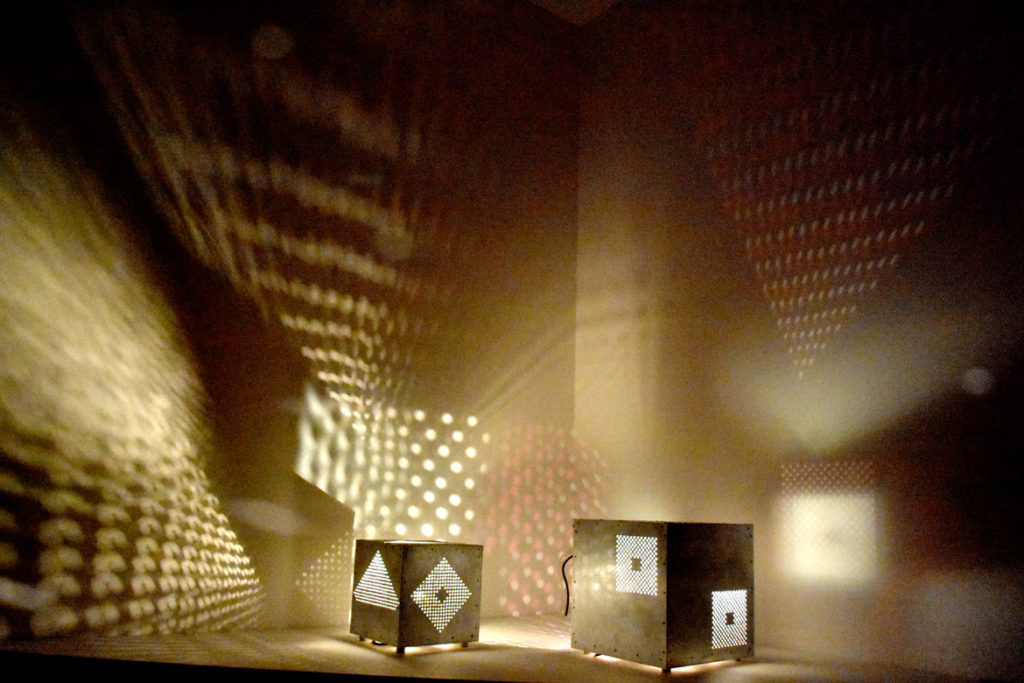 """""""Light Cubes,"""" 1990s, metal, motor, light, in """"Fire and Light: Otto Piene in Groton, 1983–2014"""" at the Fitchburg Art Museum, 2019. (Greg Cook)"""