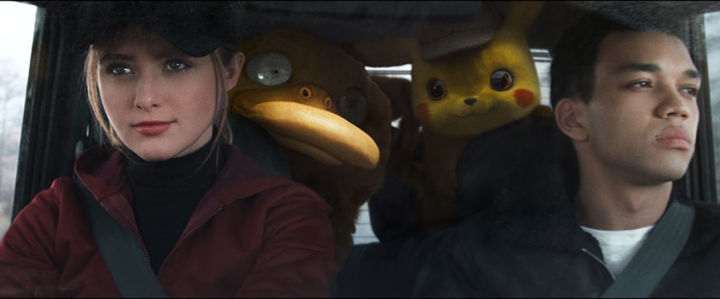 """""""Pokémon Detective Pikachu"""": From left, L-R) Kathryn Newton as Lucy Stevens, Psyduck, Detective Pikachu (Ryan Reynolds) and Justice Smith as Tim Goodman. (Courtesy: Legendary Pictures and Warner Bros. Pictures)"""