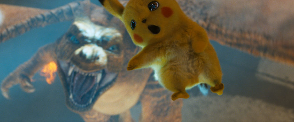 """""""Pokémon Detective Pikachu"""": Charizard and Detective Pikachu (Ryan Reynolds). (Courtesy: Legendary Pictures and Warner Bros. Pictures)"""