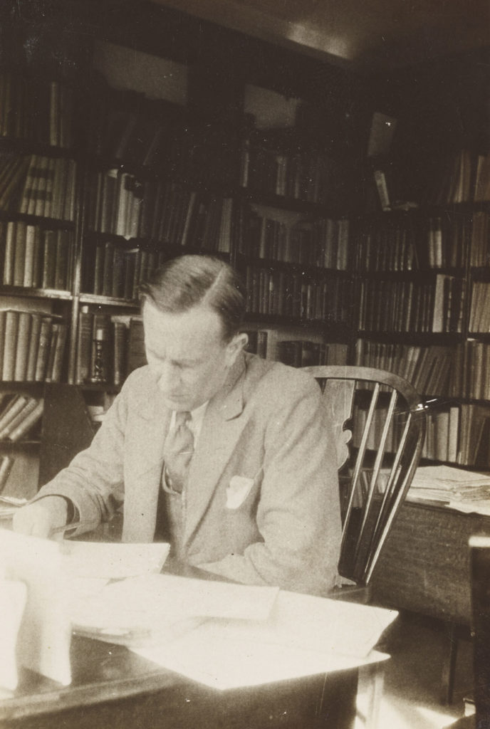 J. R. R. Tolkien in his study, ca. 1937, black and white photograph. ( © The Tolkien Trust)