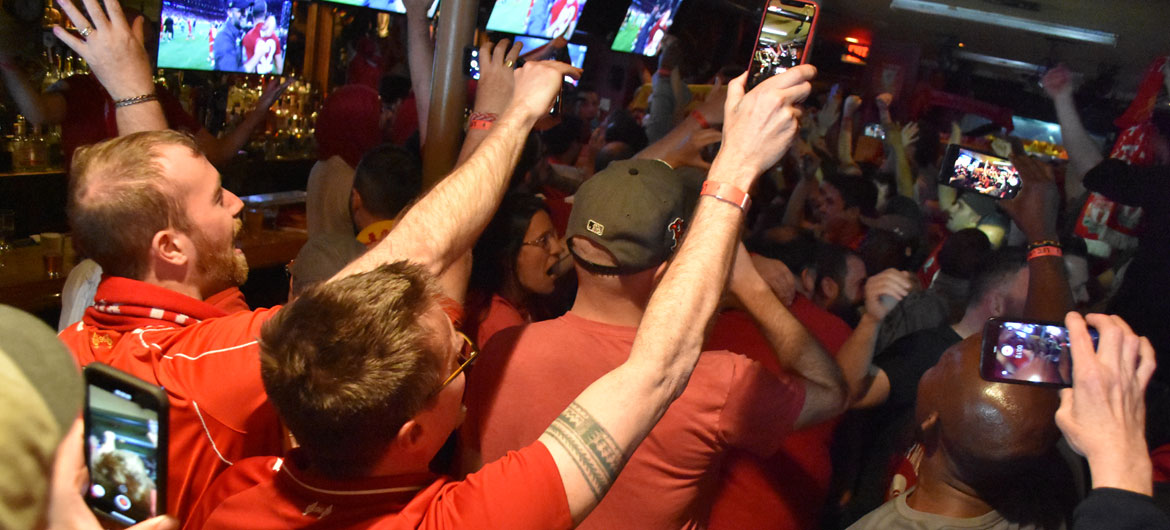 Liverpool fans celebrate the UK soccer team's Champions League Final victory at Cambridge's Phoenix Landing, June 1, 2019. (Greg Cook)