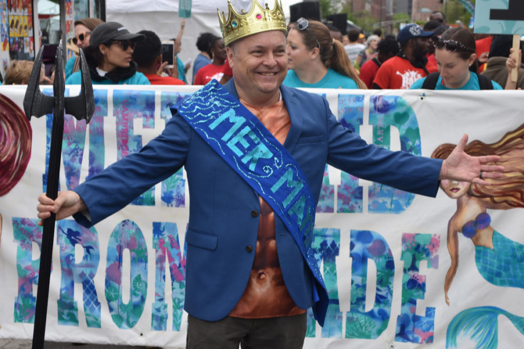 "The ""Mer-Mayor,"" Cambridge Mayor Marc Mcgovern, in the Mermaid Promenade at Cambridge Arts River Festival in Central Square, June 1, 2019. (Greg Cook)"