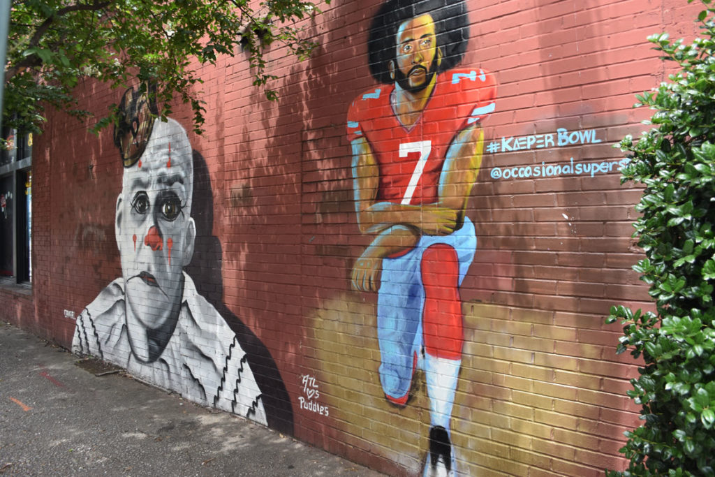 Mural of Puddles the clown and Colin Kaepernick in Atlanta, Georgia, June 24, 2019. (Greg Cook)