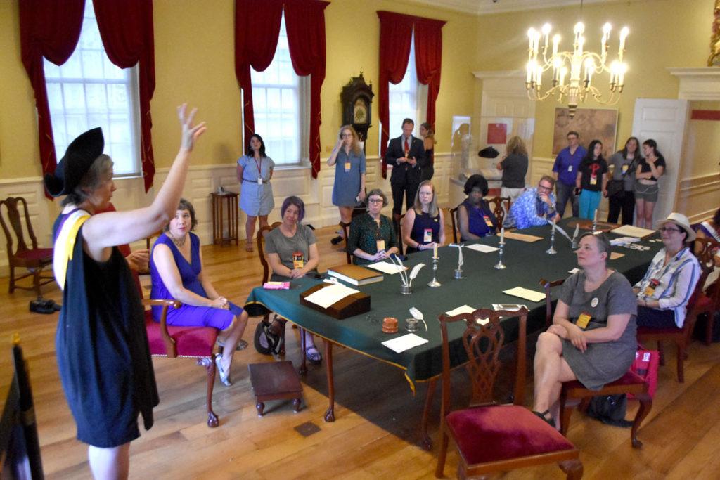 "Jen Deaderick speaks at the ""Her Flag"" celebration at the Old State House, Boston, July 25, 2019. (Greg Cook)"