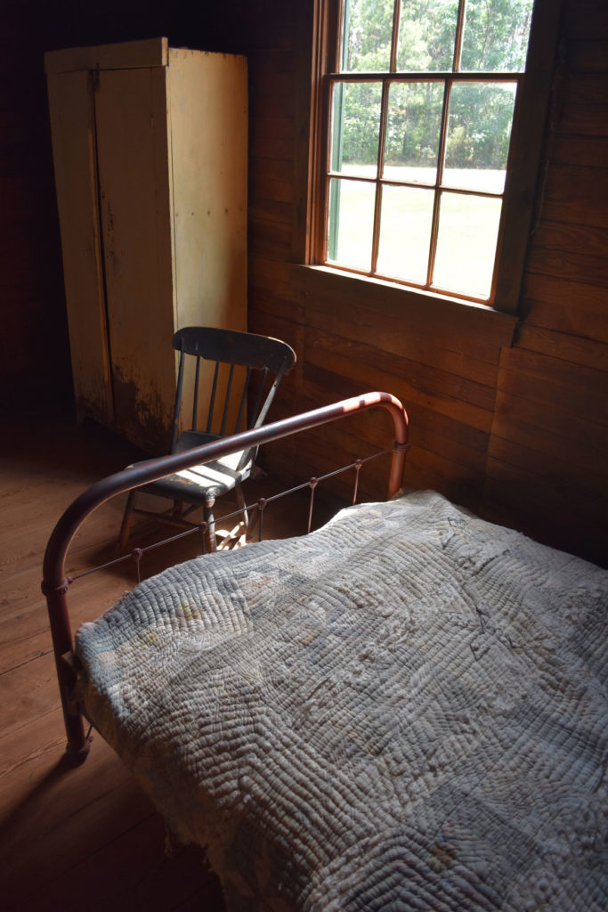 "Restored bedroom of tenant house on Carter farm at Plains, Georgia, occupied by African-American farm supervisor Tyler ""Jack"" Clark and his wife Rachel. June 23, 2019. (Greg Cook)"