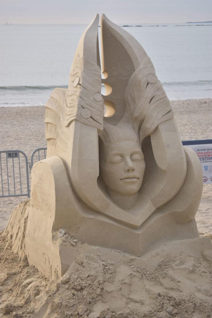 Sculpture by Aleksei Rybak of Russia at the Revere Beach International Sand Sculpting Festival, Massachusetts, July 27, 2019. (Greg Cook)