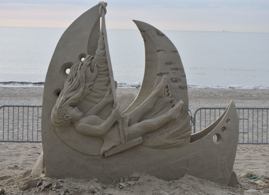Sculpture by Benoit Dutherage of France at the Revere Beach International Sand Sculpting Festival, Massachusetts, July 27, 2019. (Greg Cook)