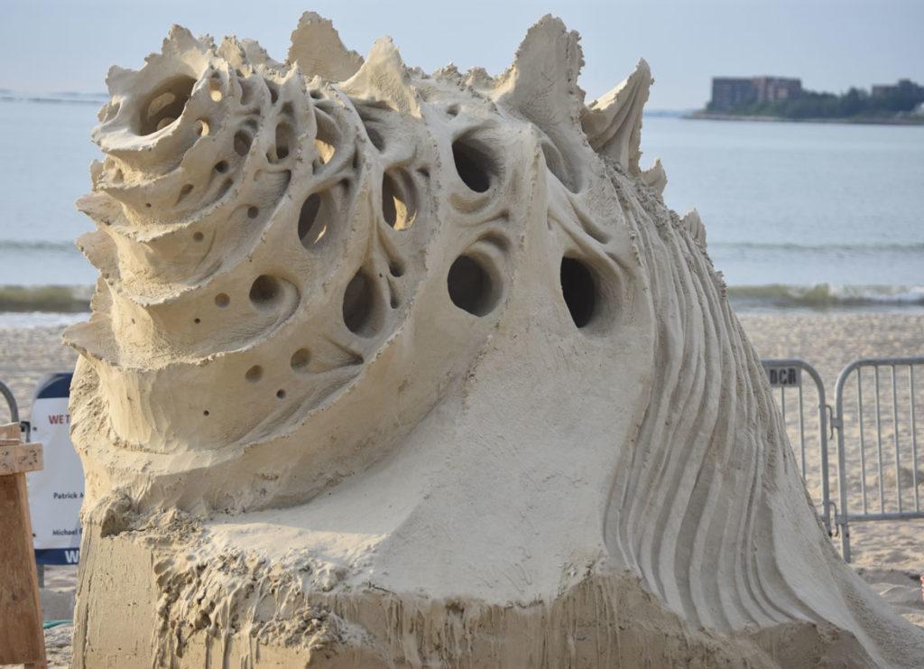 "Sculpture by Jonathan ""Jobi"" Bouchard of Canada at the Revere Beach International Sand Sculpting Festival, Massachusetts, July 27, 2019. (Greg Cook)"