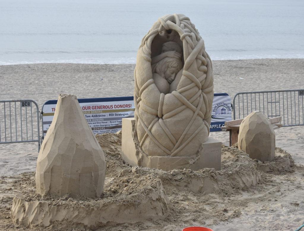 Sculpture by Melineige Beauregard of Canada at the Revere Beach International Sand Sculpting Festival, Massachusetts, July 27, 2019. (Greg Cook)