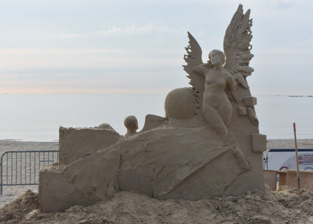 Sculpture by Ilya Filimontsev of Russiai at the Revere Beach International Sand Sculpting Festival, Massachusetts, July 27, 2019. (Greg Cook)