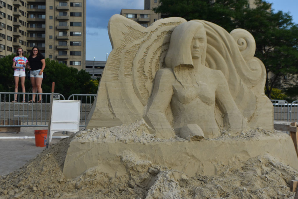 Sculpture by Sue McGrew of Washington at the Revere Beach International Sand Sculpting Festival, Massachusetts, July 27, 2019. (Greg Cook)
