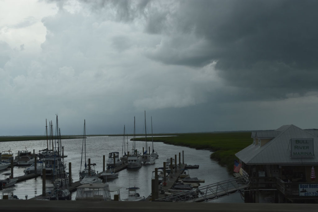 Storm clouds at Bull River Marina, Tybee Island, Savannah, Georgia, June 22, 2019. (Greg Cook)