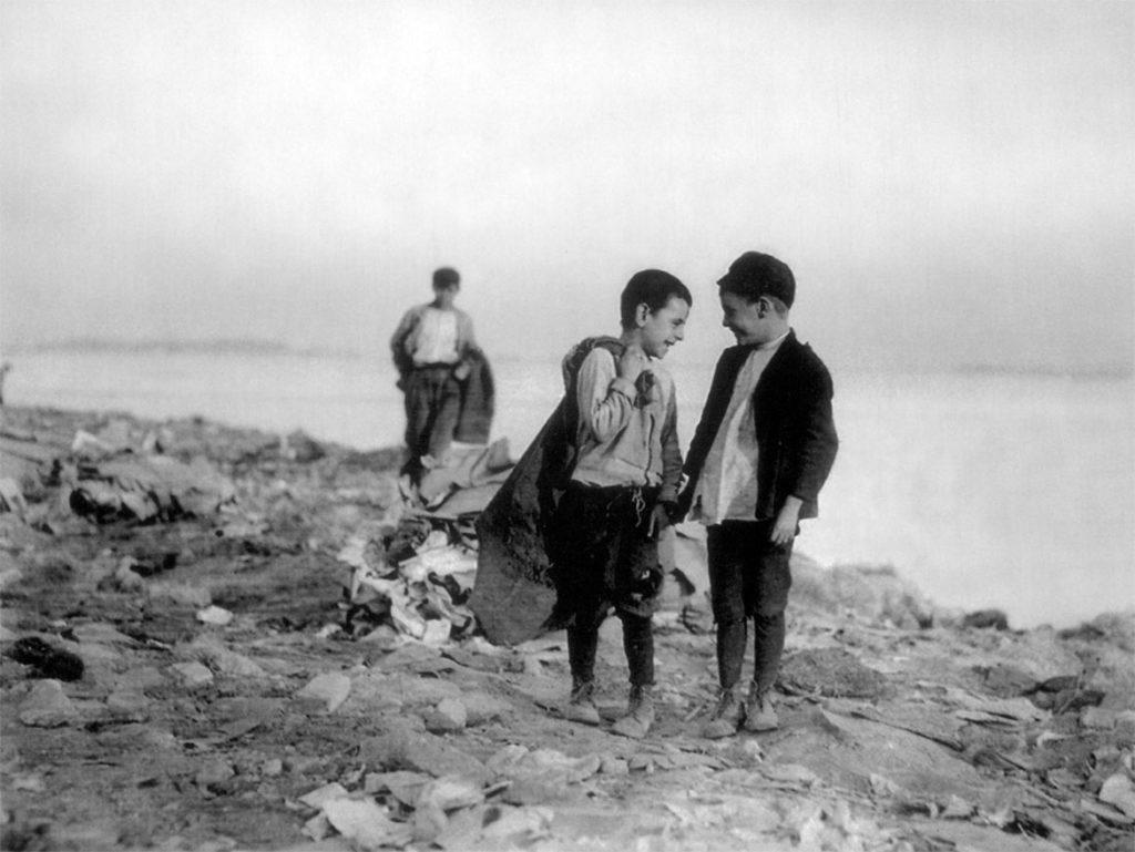 "Lewis Wickes Hine, ""Boys Picking over Garbage in ""the Dumps"", Boston,"" 1909. (Courtesy Isabella Stewart Gardner Museum)"