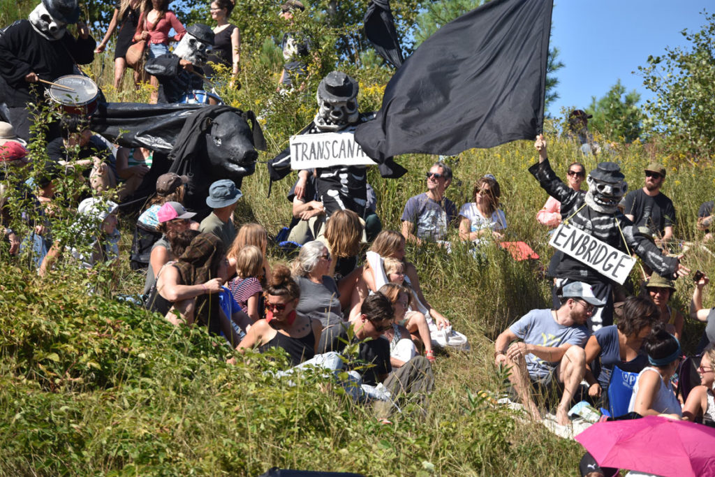 "Pipeline comes to threaten water in Bread and Puppet Theater's ""Diagonal Life Circus,"" Glover, Vermont, Aug. 25, 2019. (Greg Cook)"