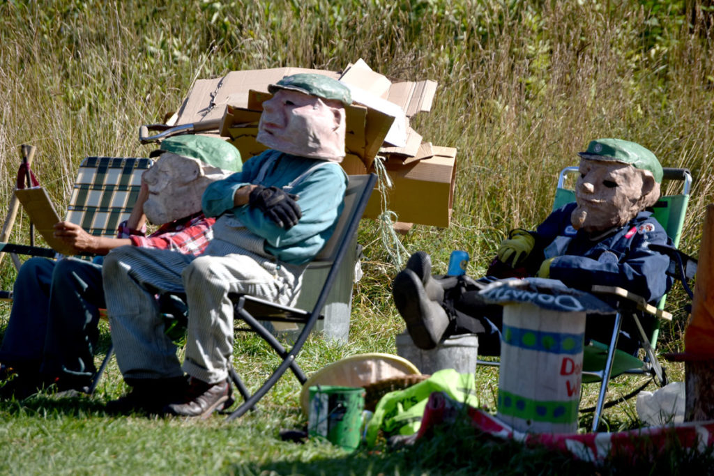 "Garbagemen take in Bread and Puppet Theater's ""Diagonal Life Circus,"" Glover, Vermont, Aug. 25, 2019. (Greg Cook)"