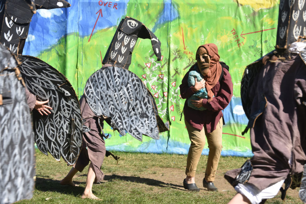 "Ravens threaten a migrant mother in Bread and Puppet Theater's ""Diagonal Life Circus,"" Glover, Vermont, Aug. 25, 2019. (Greg Cook)"