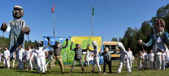 """Migrant workers in Vermont are arrested by federal immigration police in Bread and Puppet Theater's """"Diagonal Life Circus,"""" Glover, Vermont, Aug. 25, 2019. (Greg Cook)"""