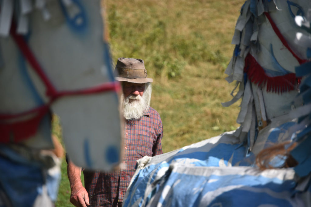 "Peter Schumann observes a rehearsal of Bread and Puppet Theater's ""Diagonal Life Circus,"" Glover, Vermont, Aug. 25, 2019. (Greg Cook)"