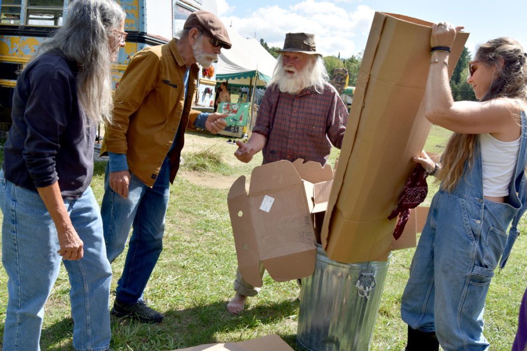 "Peter Schumann (second from right) directs garbagemen in a rehearsal for Bread and Puppet Theater's ""Diagonal Life Circus,"" Glover, Vermont, Aug. 25, 2019. (Greg Cook)"