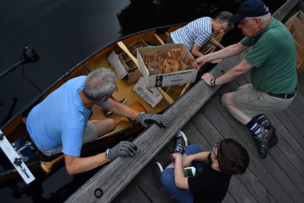 Loading a canoe with lanterns for the Remembering Hiroshima and Nagasaki Vigil in Watertown Square, Aug. 4, 2019. (Greg Cook)