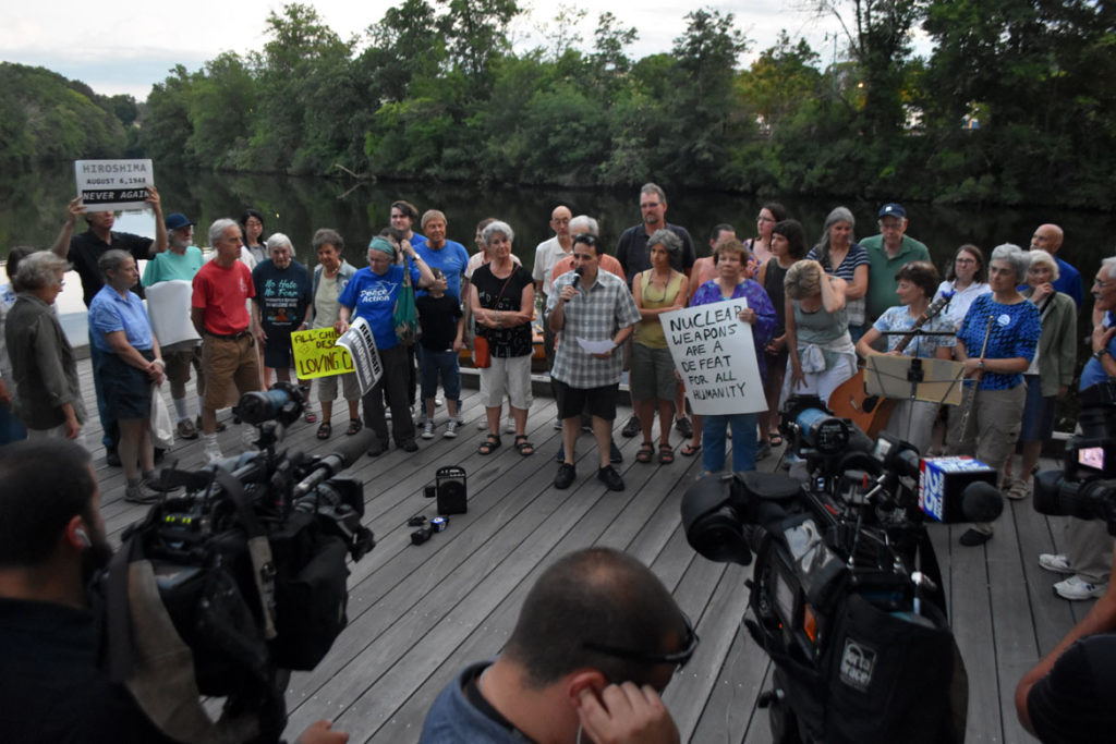 Television cameras recorded the Remembering Hiroshima and Nagasaki Vigil in Watertown Square, Aug. 4, 2019. (Greg Cook)