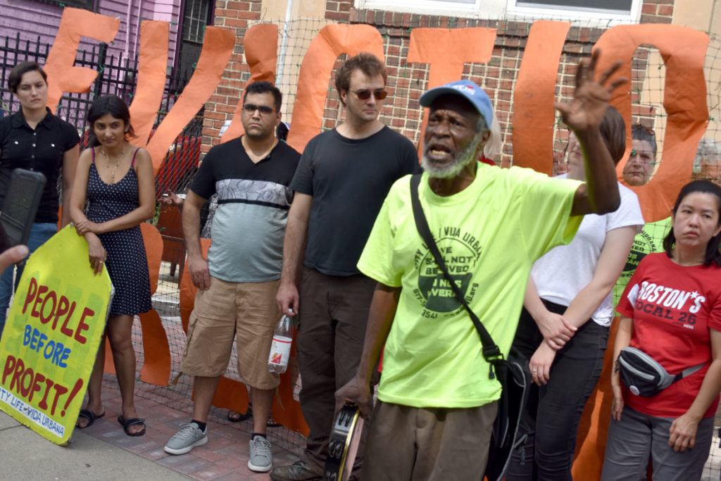 Bruce Green of the Stony Brook Tenants Association speaks at the City Life/Vida Urbana rally to support renters fighting hikes of nearly 50 percent at 33 Park St., Malden, Aug. 3, 2019. (Greg Cook)