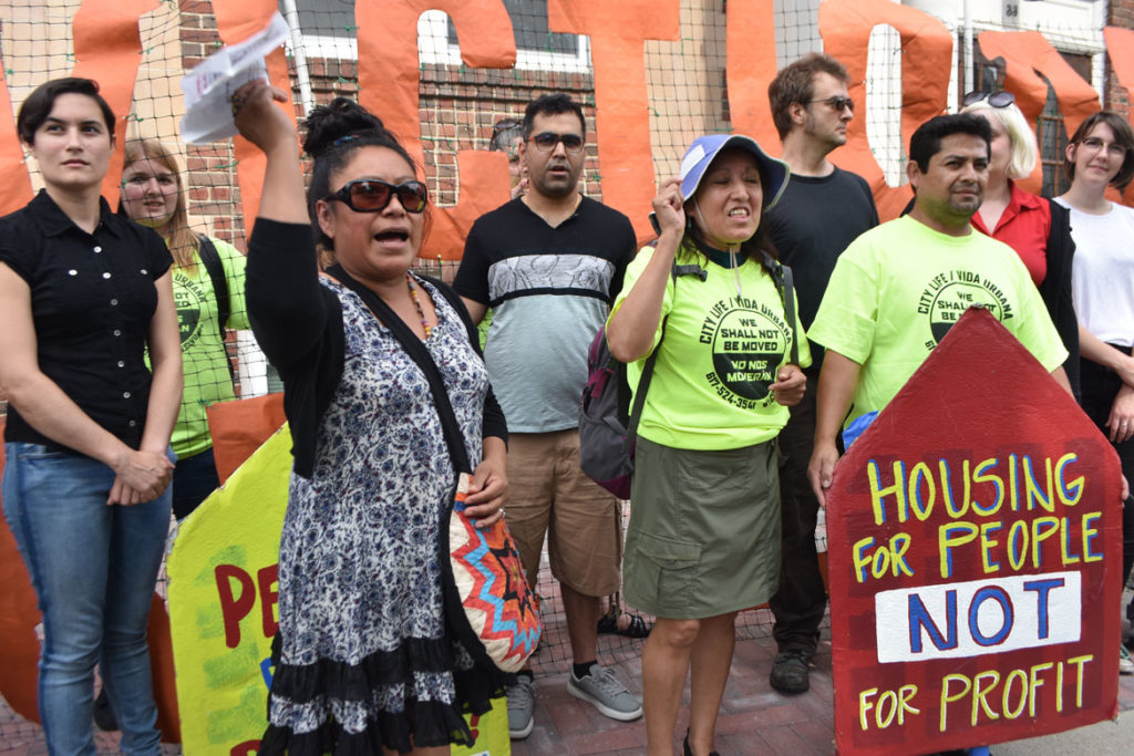 East Boston and Jamaica Plain activists speak at the City Life/Vida Urbana rally to support renters fighting hikes of nearly 50 percent at 33 Park St., Malden, Aug. 3, 2019. (Greg Cook)