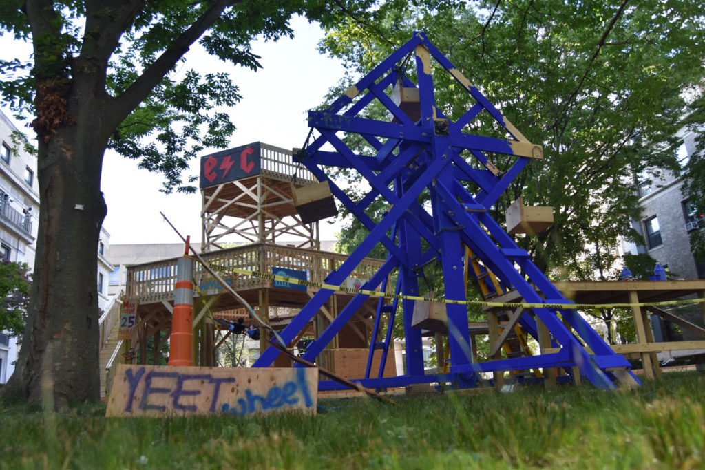 DIY cart track, Ferris wheel and fort at MIT's East Campus, Cambridge, Aug. 29, 2019. (Greg Cook)