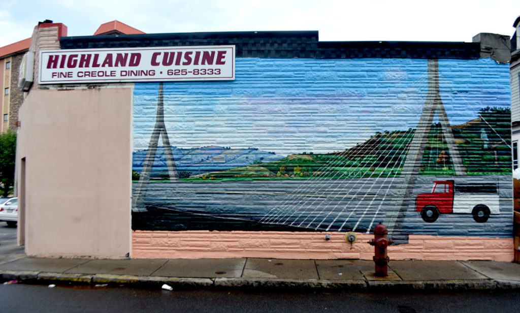 Pascal Michel's mural on the side of Highland Creole Cuisine, 2 Highland Ave., Somerville, on Aug. 21, 2019. (Greg Cook)