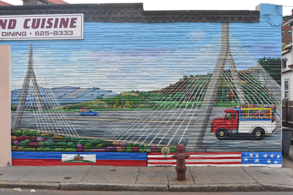 Pascal Michel's mural on the side of Highland Creole Cuisine, 2 Highland Ave., Somerville, on the morning of Aug. 28, 2019. (Greg Cook)