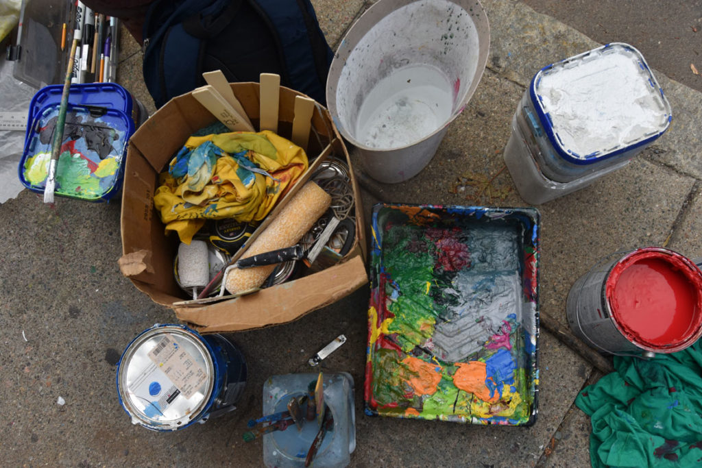 Pascal Michel's supplies for his mural on the side of Highland Creole Cuisine, 2 Highland Ave., Somerville, Aug. 28, 2019. (Greg Cook)