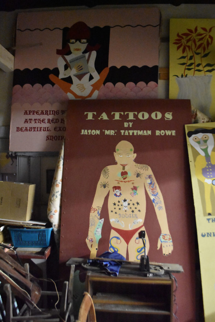"""Tattoos"" painting inside Stephen Leakos's Skowhegan Downtown Art Gallery and Leakos Auction, Skowhegan, Maine, Jul 30, 2019. (Greg Cook)"