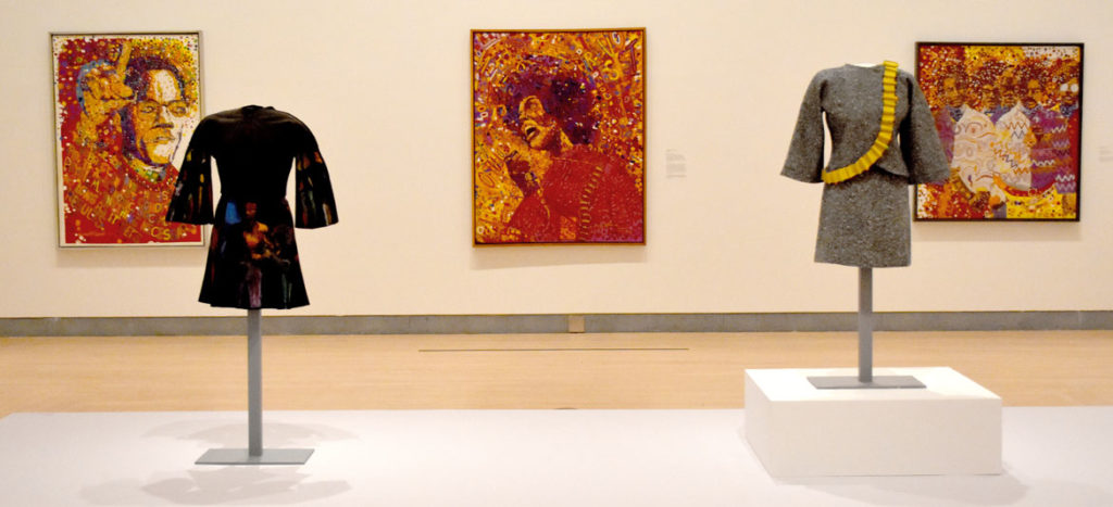 "Wadsworth Jarrell paintings and Jae Jarrell outfits at ""Soul of a Nation,"" Brooklyn Museum, Sept. 12, 2018. (Greg Cook)"