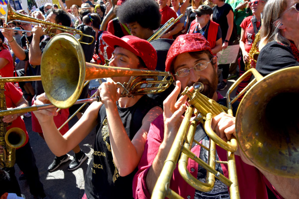 The Second Line Social Aid & Pleasure Society Brass Band plays at Boston Climate Strike, outside the Massachusetts State House, Sept. 20, 2019. (Greg Cook)
