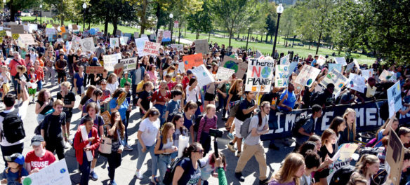 The Boston Climate Strike heads up Park Street to the Massachusetts State House, Sept. 20, 2019. (Greg Cook)