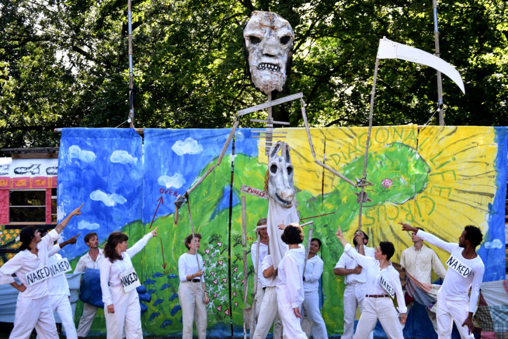 "Death rides during Bread and Puppet Theater's ""Diagonal Life Circus"" at Cambridge Common, Aug. 31, 2019. (Greg Cook)"