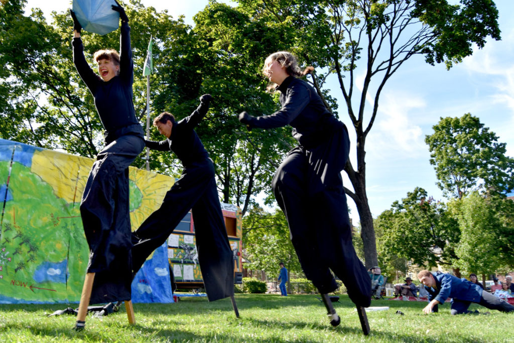 "Stilters-burglars swipe a giant diamond during Bread and Puppet Theater's ""Diagonal Life Circus"" at Cambridge Common, Aug. 31, 2019. (Greg Cook)"