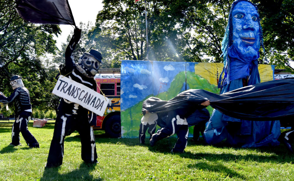 "Anti-pipeline act during Bread and Puppet Theater's ""Diagonal Life Circus"" at Cambridge Common, Aug. 31, 2019. (Greg Cook)"