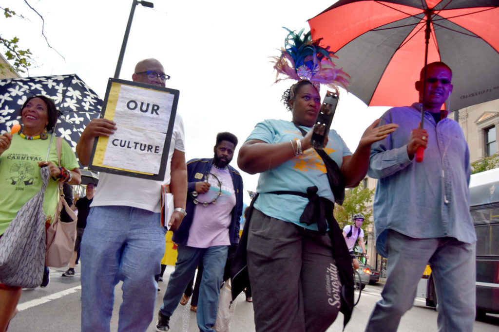 """""""March for Peace"""" down Cambridge's Massachusetts Avenue in response to the cancellation of the 2019 Carnival. Sept. 4, 2019. (Greg Cook)"""