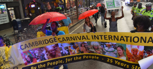 "The Cambridge Carnival Committee led a ""March for Peace"" down Cambridge's Massachusetts Avenue in response to the cancellation of the 2019 Carnival. Sept. 4, 2019. (Greg Cook)"