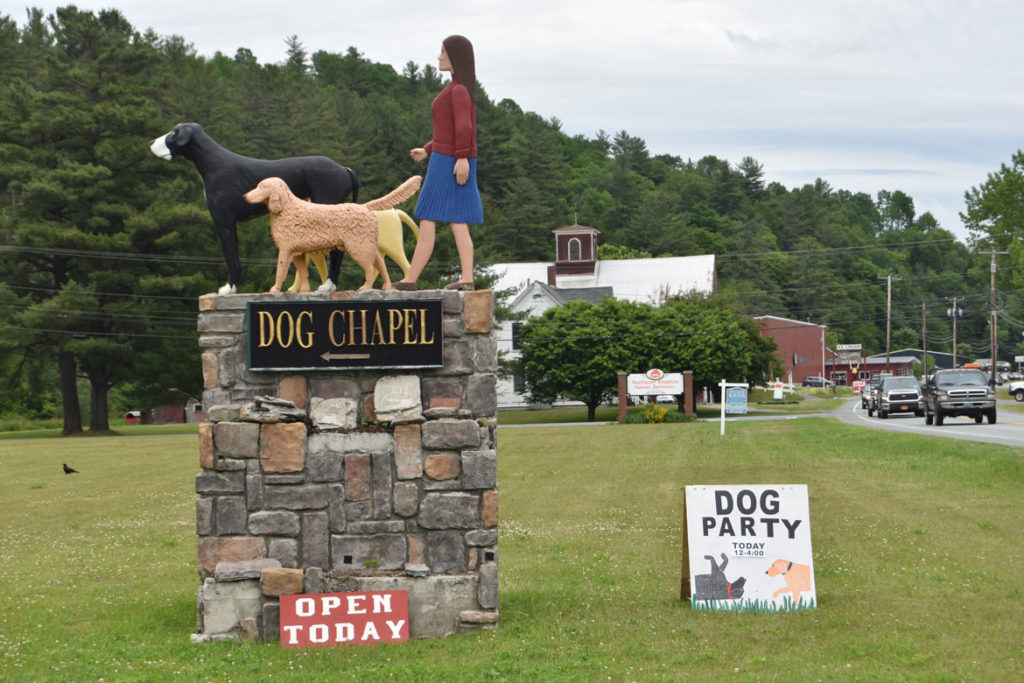 Sign for Stephen Huneck's Dog Chapel, St. Johnsbury, Vermont, June 23, 2018. (Greg Cook)