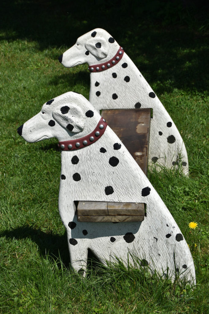Dalmatians bench next to water lily pond at Stephen Huneck's Dog Mountain, St. Johnsbury, Vermont, Aug. 26, 2019. (Greg Cook)