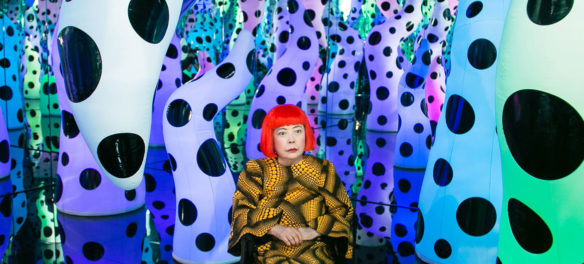 "Yayoi Kusama pictured with her work ""Love Is Calling"" during her solo exhibition ""I Who Have Arrived In Heaven"" at David Zwirner gallery, New York, 2013. (Courtesy ICA Boston)"